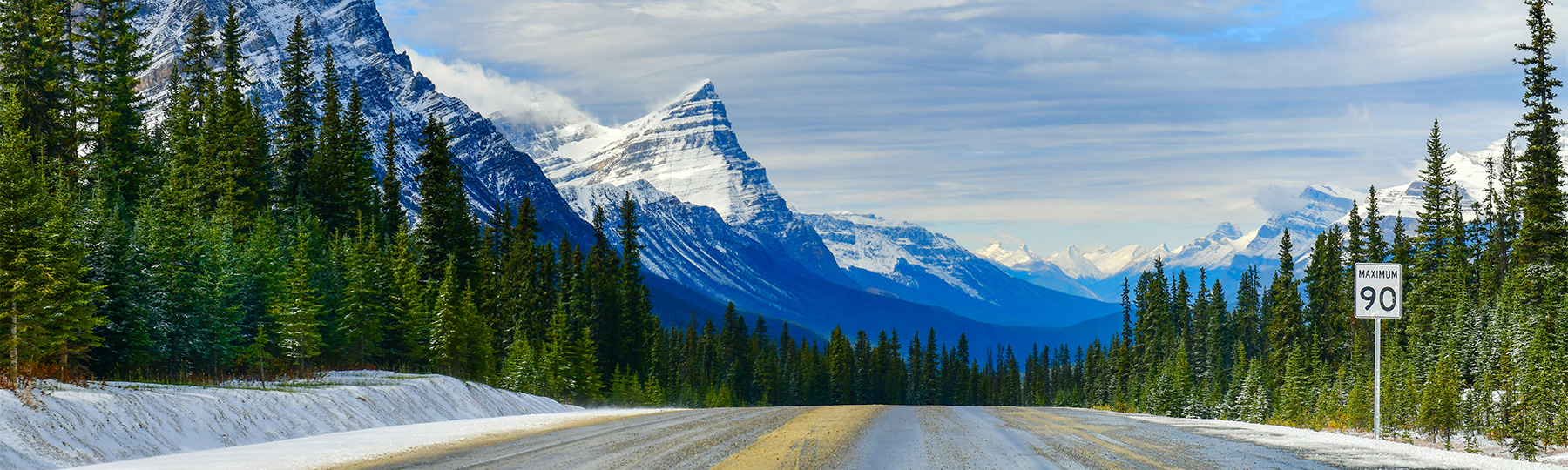 Photo of a Canadian Highway with a mountain backdrop